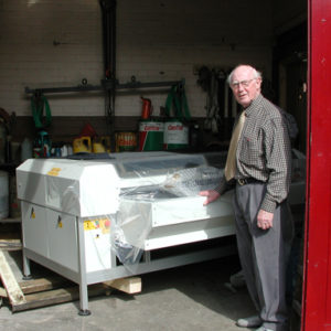 Eric Ramsbottom taking delivery of New Laser Cutter 12 08 04